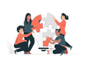 Grafik: vier Frauen und Männer setzen Puzzleteile zusammen - Konzipieren eines Sprachtrainings durch das IKS-Team